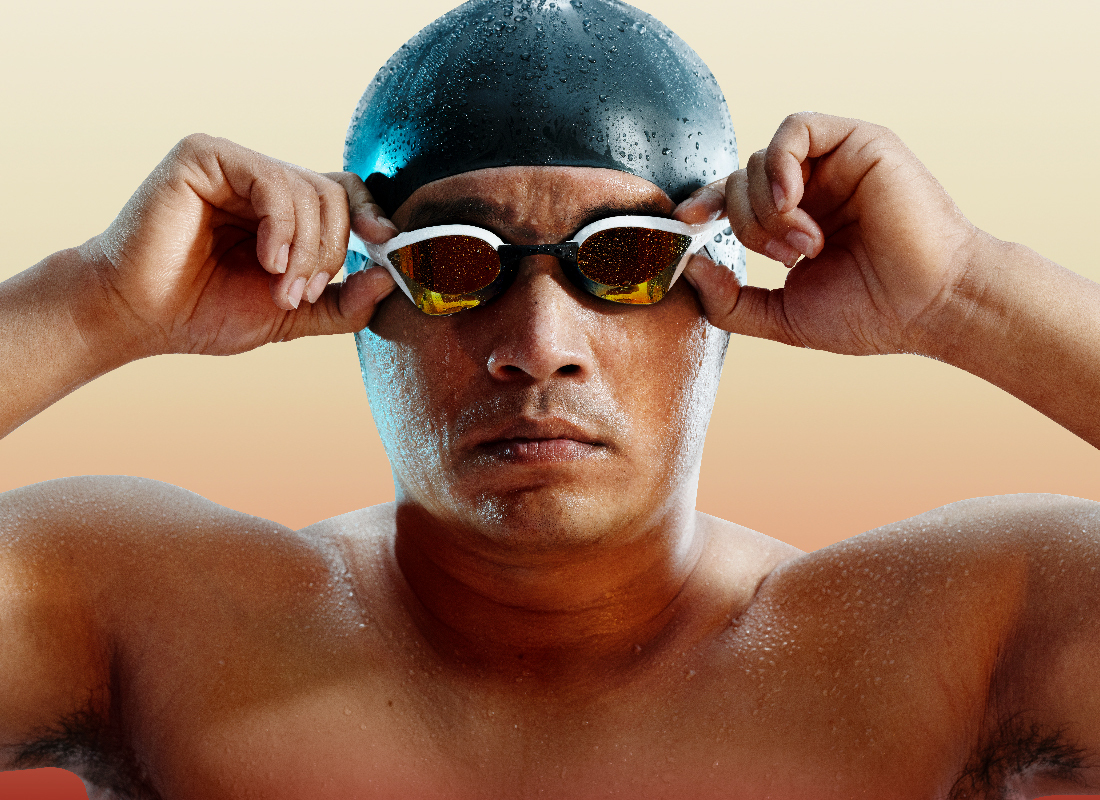 Thanh Trung adjusts his mirrored swimming goggles as droplets of pool water shine on his swim cap.