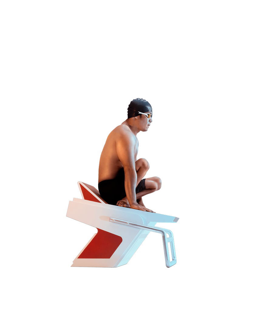Thành Trung Nguyễn waits in the starting blocks on the side of the pool, ready to compete.